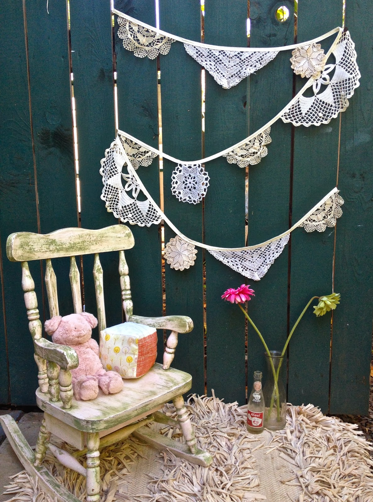 bunting doily rocking chair pig soft block flowers on a fence