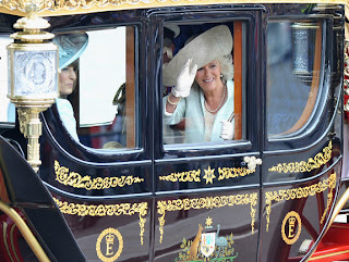 Mother of the Bride Carole Middleton (l.) and Camilla, Duchess of Cornwall make the journey by carriage procession to Buckingham Palace after the Royal Wedding.