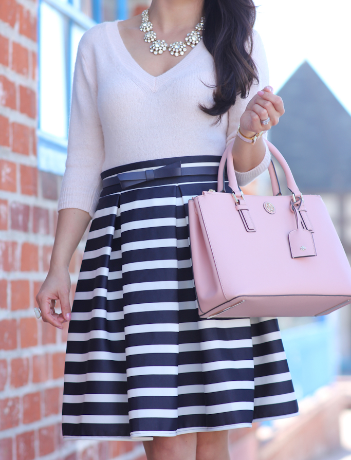 navy striped skirt pink v-neck sweater kate spade new york bow belt tory burch mini robinson double zip tote rose sachet nude pumps ily couture juliet necklace