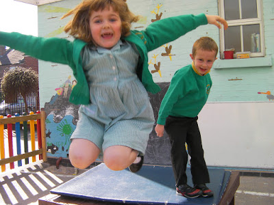 jumping in the playground in school uniform