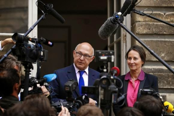 French Ecology, Sustainable Development and Energy Minister Segolene Royal (R) and Finance Minister Michel Sapin speak to the journalists after a conference about the financing of energy transition in Paris June 23, 2014. (Credit: Reuters/Benoit Tessier) Click to enlarge.