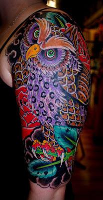 Half sleeve tattoo of a purple owl by tattoo artist Jason Kunz for Triumph Tattoo