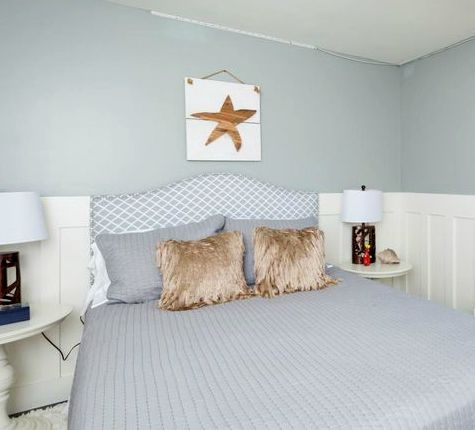 Simple Wood Starfish Art in Bedroom above Headboard