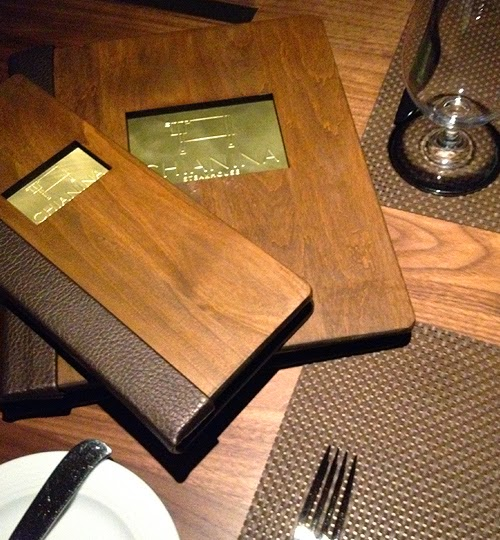 wooden covered menus on a table