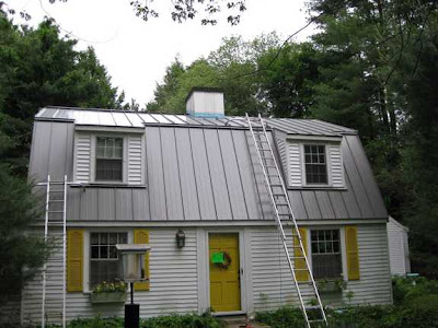 Standing Seam Metal Roof on a salt-box house in the woods