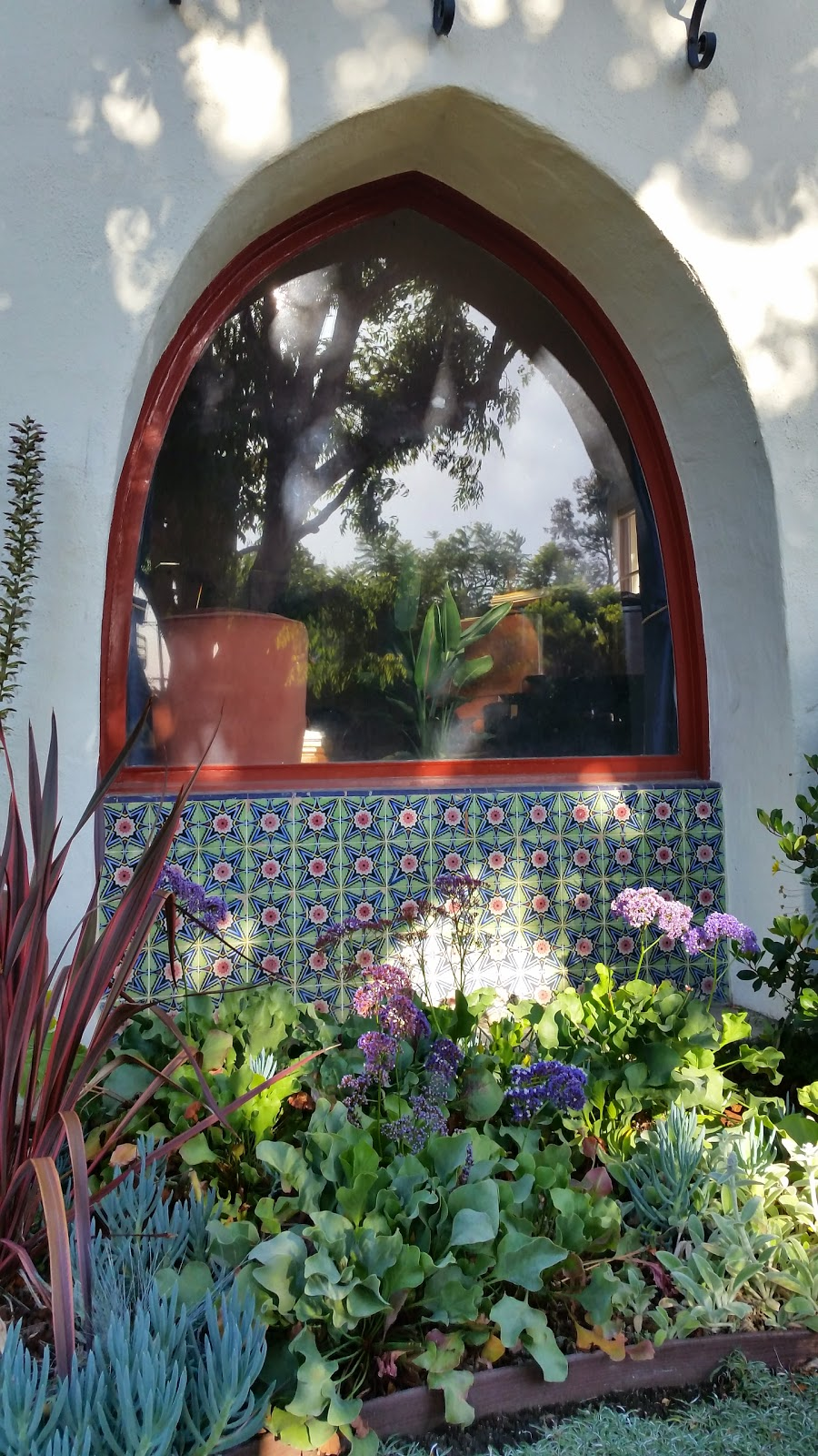 These brightly colored tiles are grouped beneath a Moorish arch to create a colorful tribute to Spanish Revival Architecture