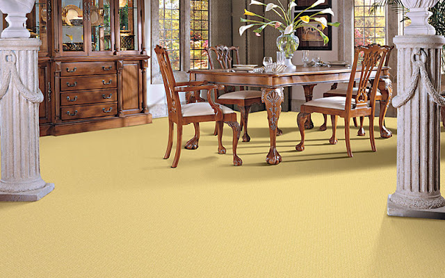 Gold carpet ties this dining room together beautifully.