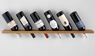 wall-mounted wine rack, like a shelf with holes in it, where necks get inserted