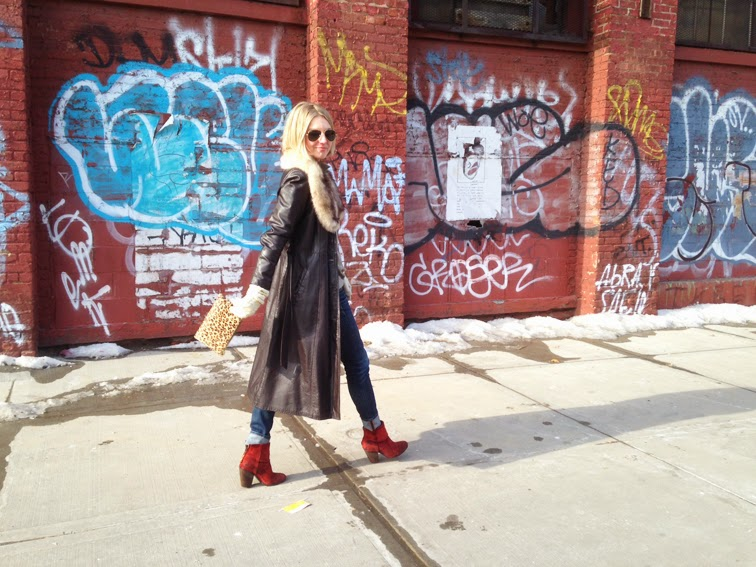 Brooklyn graffiti brick wall, red suede Rag & Bone Newbury boots, pony hair J.Crew pouch, leather trench coat, fur collar, J Brand