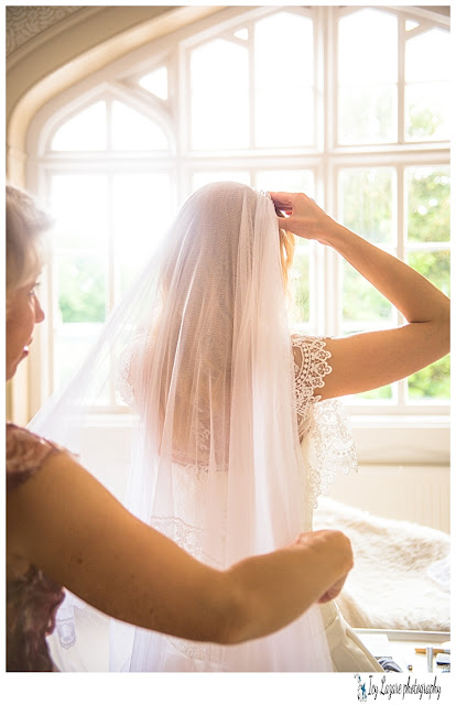 bride putting her veil