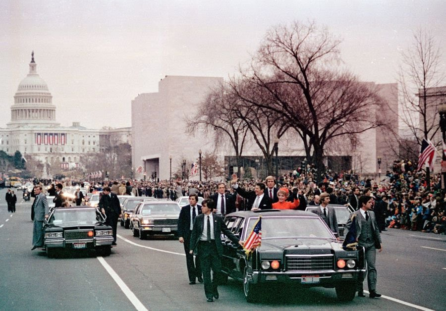 Secret Service agents protect President Reagan