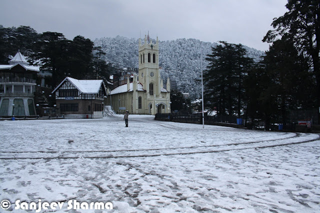 Shimla is enjoying the fresh snowfall on the hills and people have come out to celebrate in white Shimla. Let's check out these mobile clicks from Shimla by Mr Sanjeev Sharma (Senior Reporter, Zee).Here is a photograph of Shimla covered with snow layer and all white. Photograph has been clicked from one end of the mall road near Oberoi Hotel. Ridge Church looks amazing on top of the town and everything else covered with White layer of fresh snowfall.Shimla meteorological office director Manmohan Singh said, high hills of state would get heavy snowfall on Friday and moderate snowfall on Saturday. So many folks in Chandigarh & Delhi are supposed to come to Himachal to experience fresh snowfall during the weekend.A brilliantly clicked photograph of Sanjeev Sharma, which shows the view of Ridge ground in Shimla. There is a small place to overlook this whole ground and photograph is clicked from the same place. This elevated shed comes of the way from Ridge Ground to Jakhu Temple. A photograph of Shimla Club which is again situated on Mall Road. This is one of the great place to celebrate special occasions, although everyone is not allowed in Shimla Club.Hoteliers in Shimla & other places of Himachal Pradesh say snowfall would prove boon for tourism as visitors would throng Himachal to see the fresh snow. Many trourists visit Shimla during winters in a hope to see fresh snowfall happening. Traffic in these towns was partially affected in upper. There was minimal impact on main highways connecting Shimla & Manali to Chandigarh/Delhi.A view of Christ Church from mall road, just below it. This church is situated on the famous Ridge ground of Shimla.Ridge ground view after fresh snowfall in Shimla. Although there are some footsteps on the snow, which shows that many shimlites have already had a round on ridge ground to enjoy in first snowfall of 2013.Upper reaches of Himachal Pradesh received snowfall on Thursday much to the delight of tourists and residents, who had been experiencing sub-zero temperatures for the past one month. Since Thursday morning, Shimla and Manali received 5 to 8cm snow while Rohtang pass in Kullu district got over 60cm. It had last snowed in Shimla and Manali on December 14.