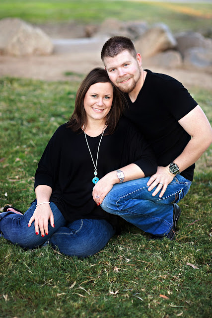 Tucson Couple pose for family Christmas portraits in a grassy location