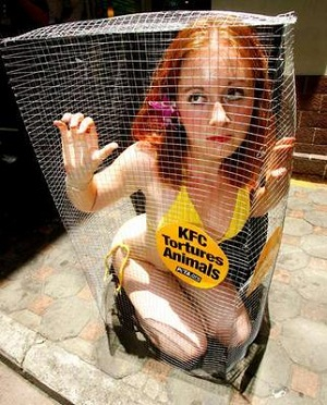 [Image: animal-rights-protester-ginger-cage-girl.jpg]