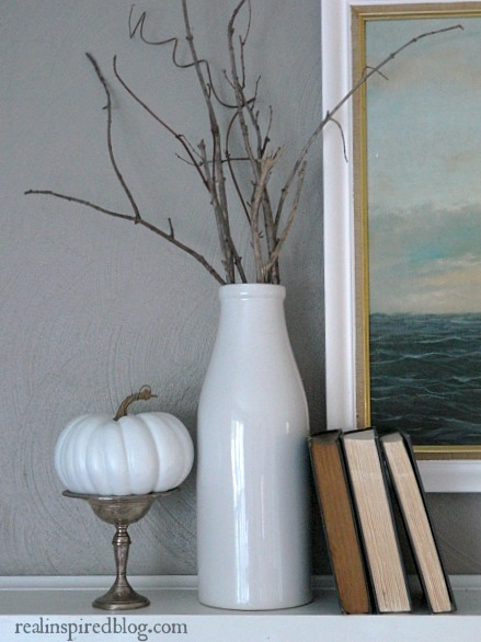 Decorating from the Yard with bare branches in a white vase for fall.