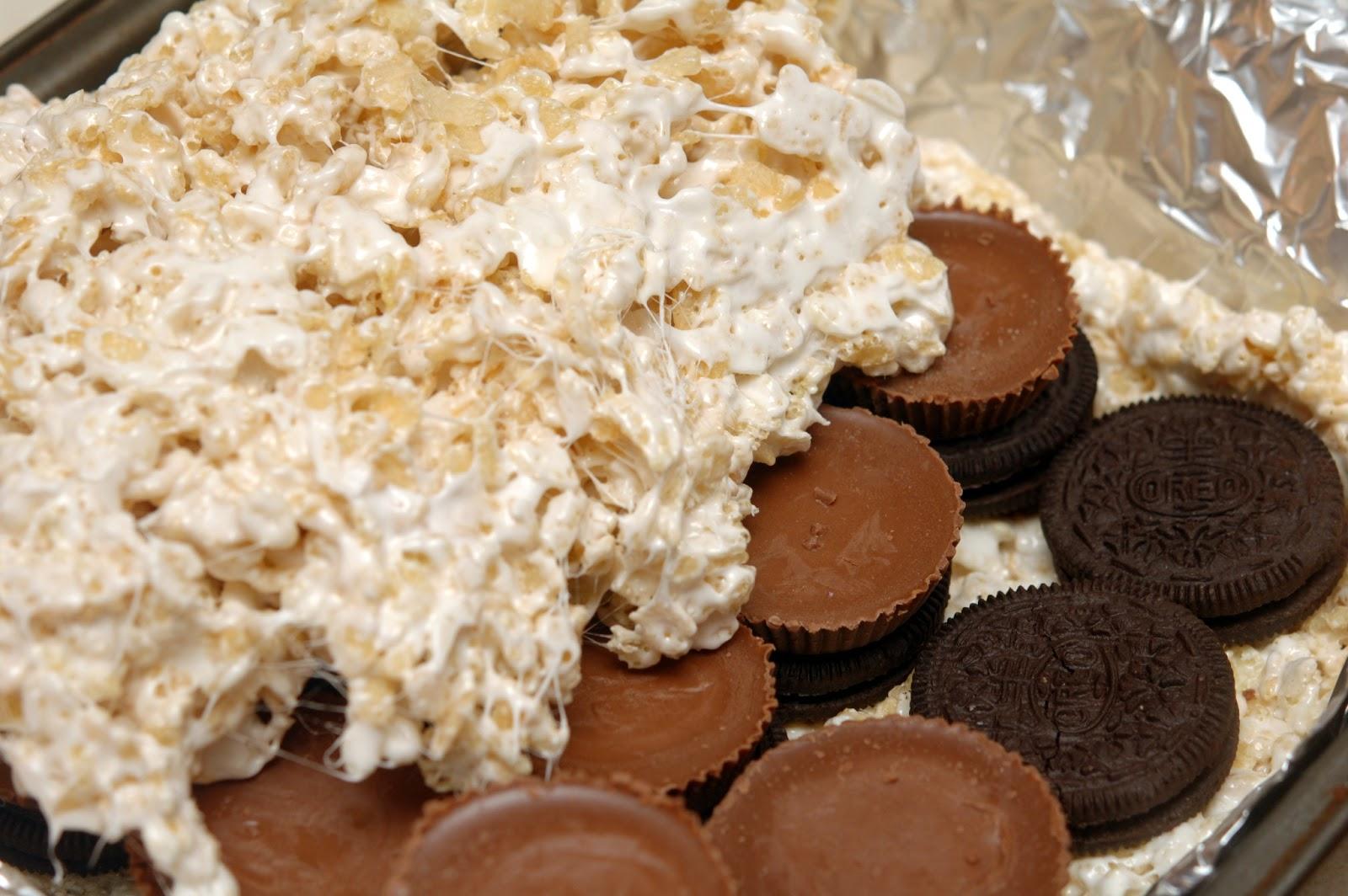 Oreo amp peanut butter cup stuffed rice krispy treats hugs and