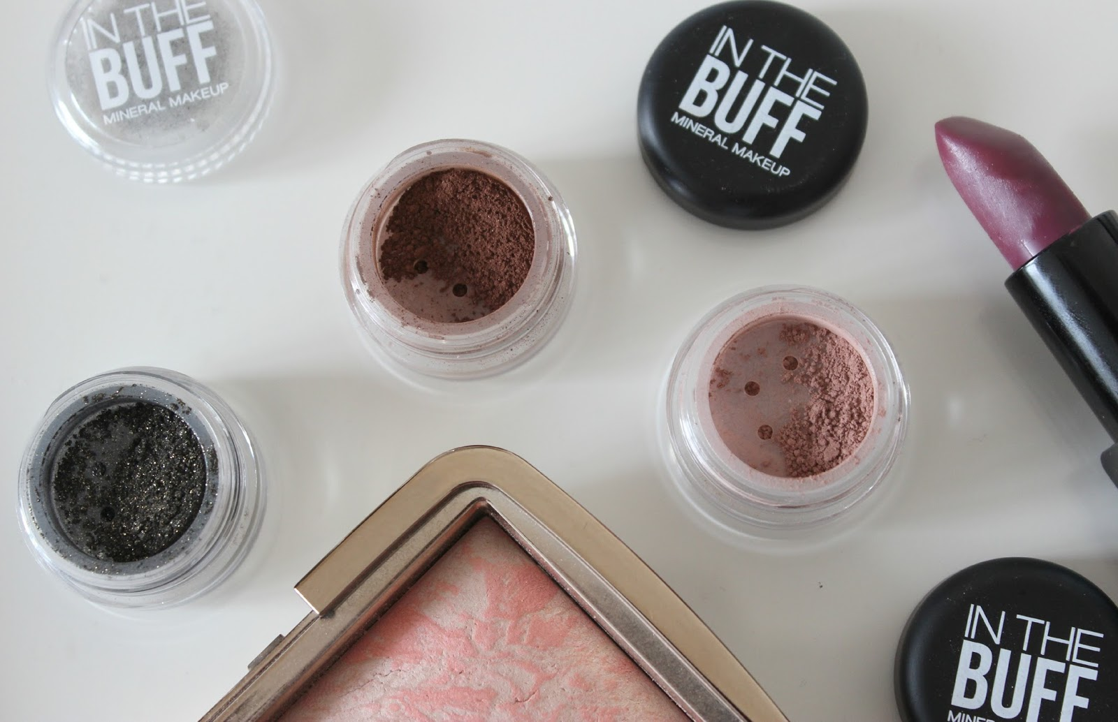 A picture of In The Buff mineral eyeshadows in Dark Skies, Baked Earth and Earth