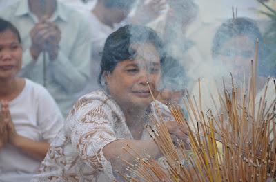 Death of King Norodom Sihanouk, mourner at Royal Palace, Phnom Penh, Cambodia