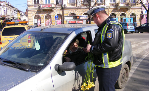 Policemen giving flowers to woman