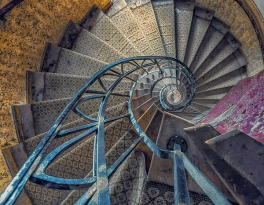 abandoned spiral stairs by Christian Richter
