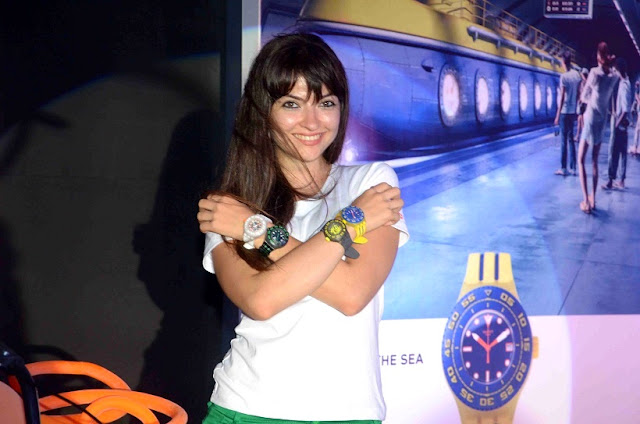 Model displaying the new and vibrant Swatch Scuba Libre Collection