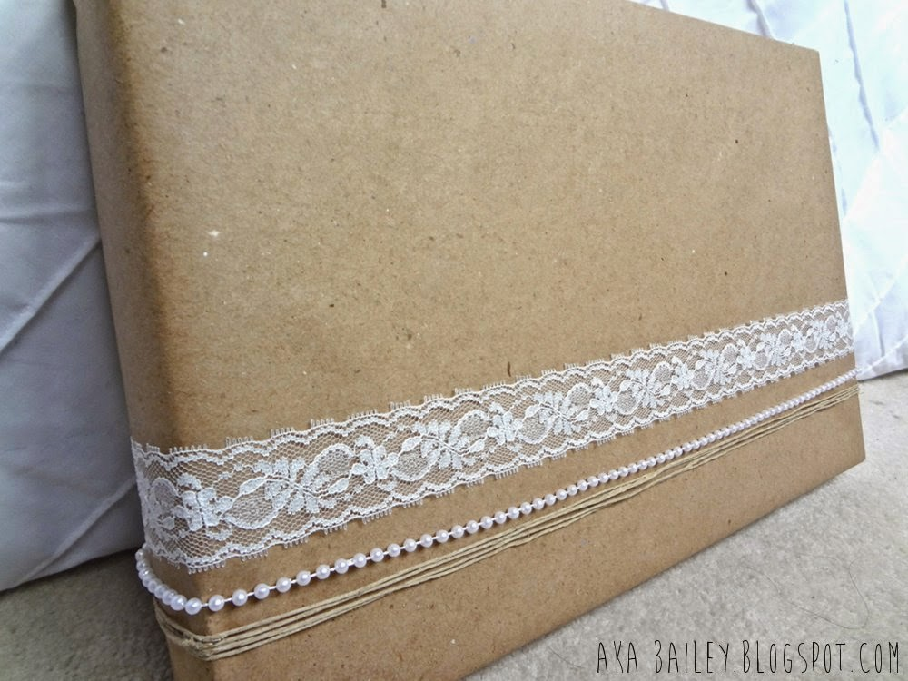 Brown paper gift wrap with lace, pearl and hemp