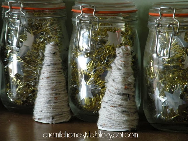 Yarn trees and jars of silver and gold tinsel - Christmas decor