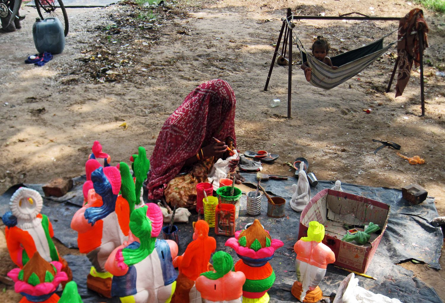 Stock Pictures Indian Artisans Making Small Statues