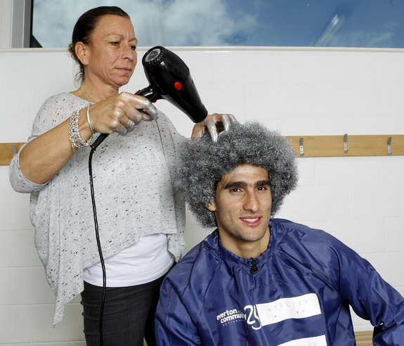Marouane Fellaini turns his trademark Afro silver