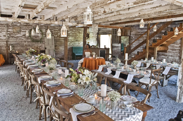 Vintage Rustic Farm Wedding Catskills shot by fine art wedding photographer Angela Cappetta view of places set for dinner in barn
