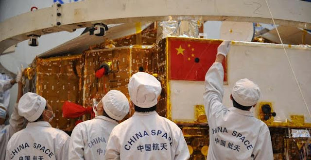 Chinese scientists work on the Chang'e-3 spacecraft. Credit: China Space News