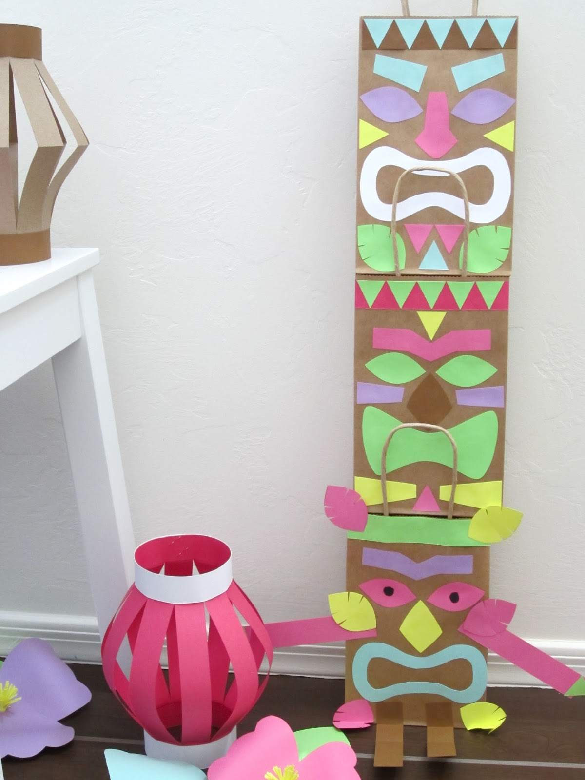 Homemade luau party paper bag tiki guy design sprinkle for Paper decorations diy