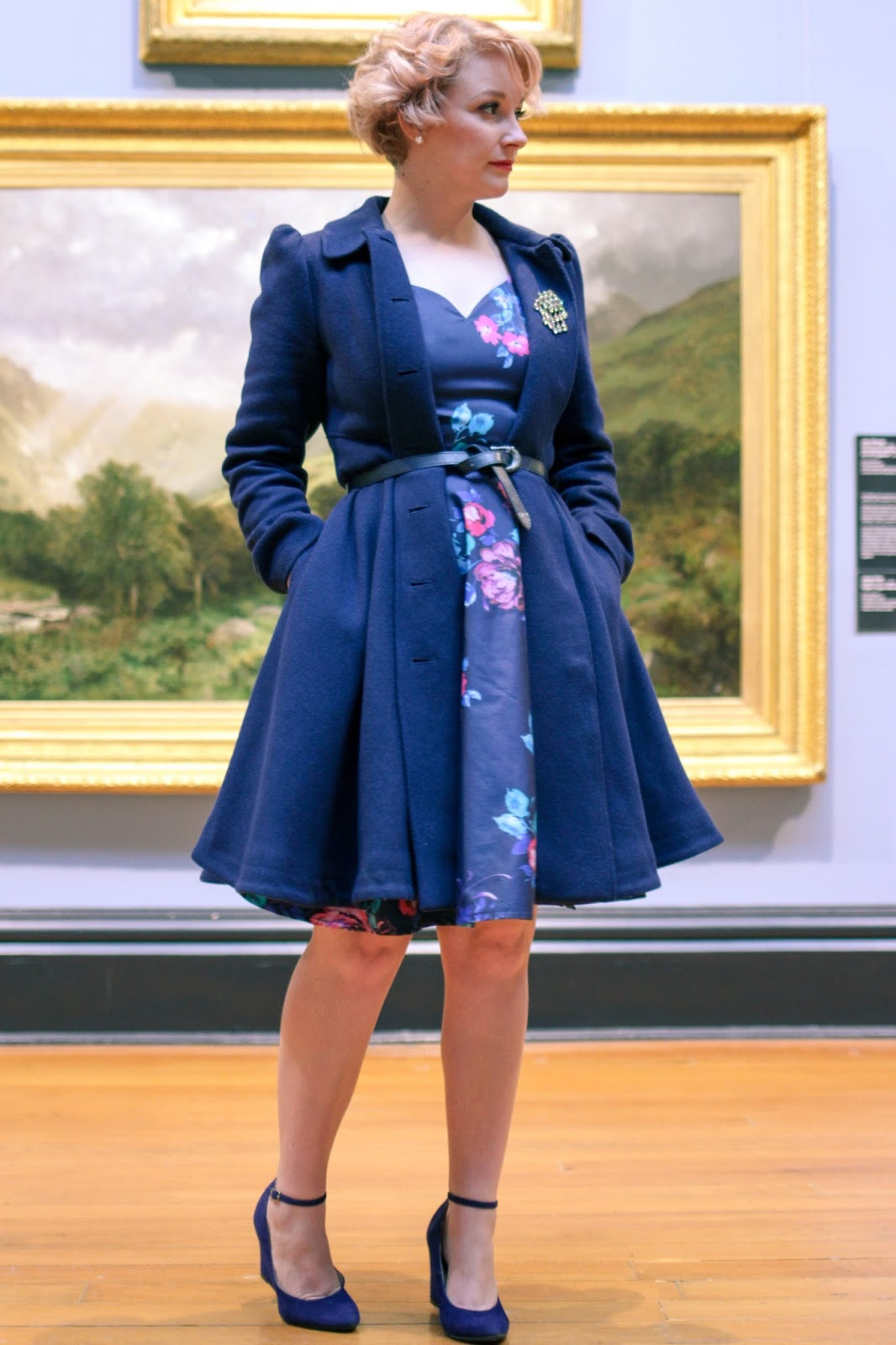 Finding Femme at the Ballarat Fine Art Gallery wearing belted Review Australia navy coat and blue floral dress with blue suede Modcloth shoes.