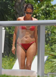 Olga Kurylenko shows off her body at a Miami pool wearing a red bikini