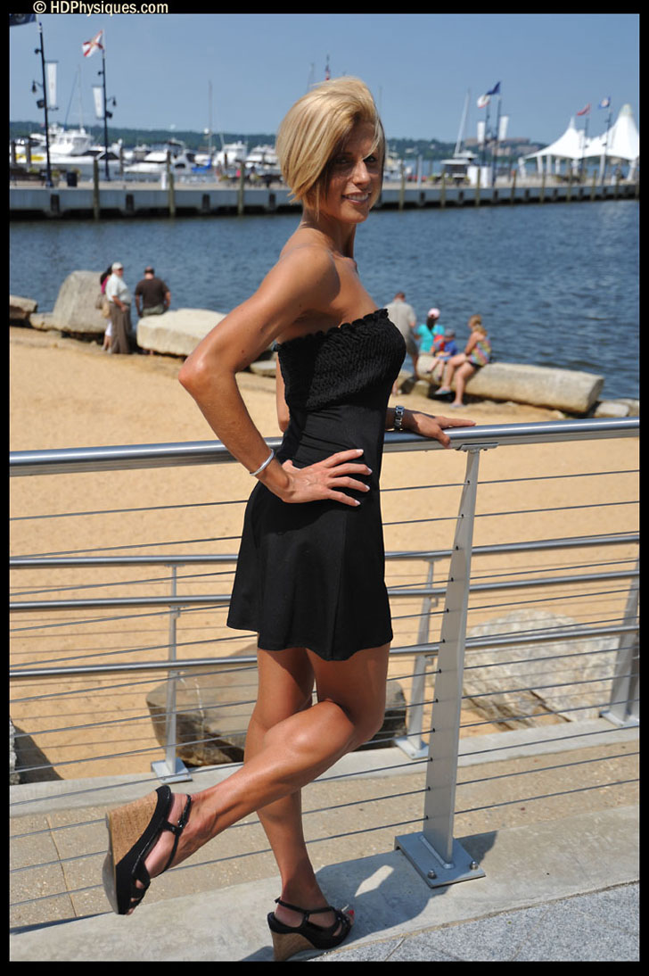 Lindsey Boswell Modeling Her Muscular Calves In A Black Dress