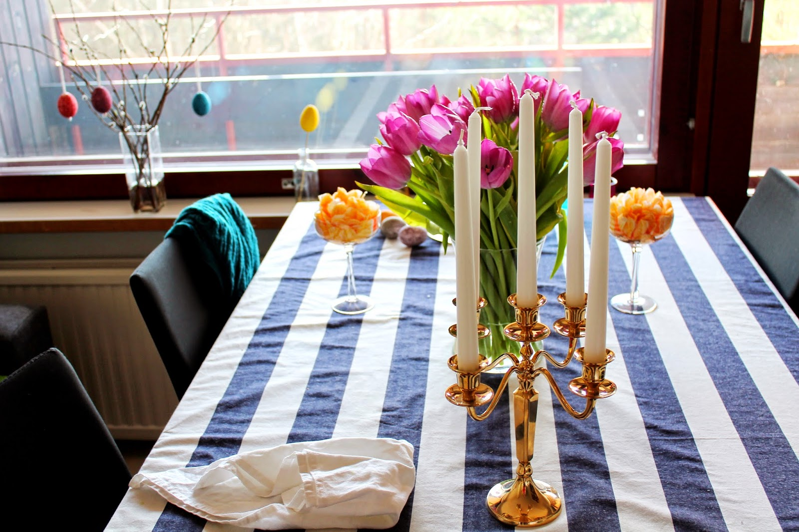 tablescape with Lexington striped tablecloth, candles and flowers
