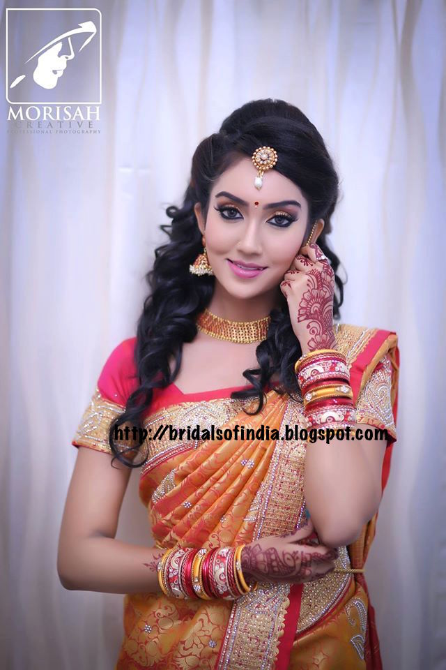 Fashion World Orange Red Silk Kanchipuram Sarees And The Hairstyle