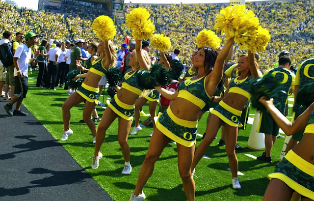 Oregon cheerleders in Nike Pro Combat uniforms. 'Nuff said.