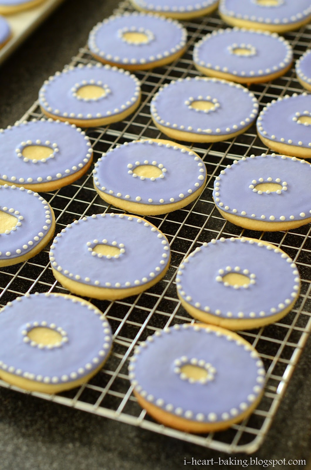 "the finishing touches ... a white dotted border on the ""O"" cookies ..."