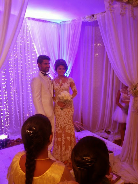 http://picture.gossiplankahotnews.com/2014/04/wedding-photos-of-bhagya-hettiarachchi.html