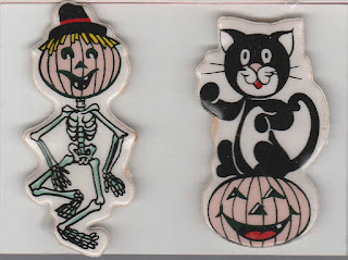 Puffy Halloween stickers featuring dancing skeleton with pumpkin head and black cat sitting on pumpkin
