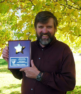 Science teacher accepts BLM award for Cedar Ridge Academy