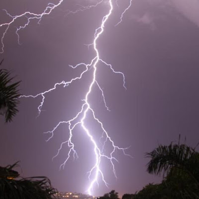 large lightning strike in purple night sky