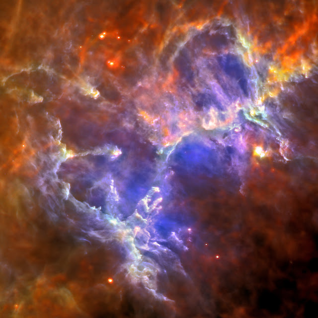 This Herschel image of the Eagle nebula shows the self-emission of the intensely cold nebula's gas and dust as never seen before. Each color shows a different temperature of dust, from around 10 degrees above absolute zero (10 Kelvin or minus 442 degrees Fahrenheit) for the red, up to around 40 Kelvin, or minus 388 degrees Fahrenheit, for the blue.   Herschel reveals the nebula's intricate tendril nature, with vast cavities forming an almost cave-like surrounding to the famous pillars, which appear almost ghostly in this view. The gas and dust provide the material for the star formation that is still under way inside this enigmatic nebula.   Far-infrared light has been color-coded to 70 microns for blue and 160 microns for green using the Photodetector Array Camera, and 250 microns for red using the Spectral and Photometric Imaging Receiver.   Herschel is a European Space Agency cornerstone mission, with science instruments provided by consortia of European institutes and with important participation by NASA. NASA's Herschel Project Office is based at NASA's Jet Propulsion Laboratory, Pasadena, Calif. JPL contributed mission-enabling technology for two of Herschel's three science instruments. The NASA Herschel Science Center, part of the Infrared Processing and Analysis Center at the California Institute of Technology in Pasadena, supports the United States astronomical community. Caltech manages JPL for NASA.   Image Credit: ESA/Herschel/PACS/SPIRE/Hill, Motte, HOBYS Key Programme Consortium Explanation from: http://www.nasa.gov/mission_pages/herschel/multimedia/pia15260.html