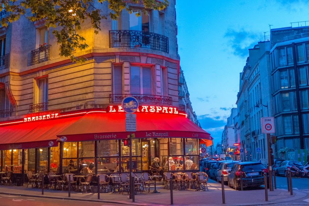 Paris France restaurant red awning twilight blue sky