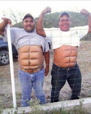 Two fat guys press their belly up against a wire fence to get an instant 6-pack