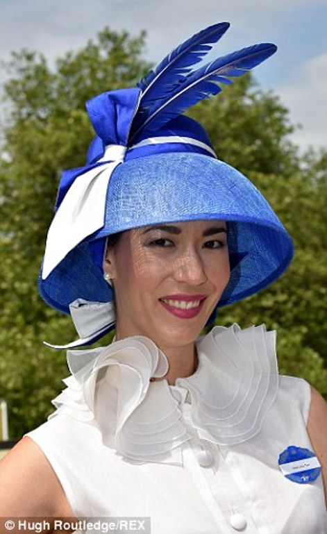 a lady in a white and blue hat with feathers on day 4 of Royal Ascot 2014