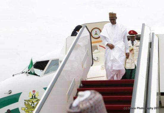 Buhari arrives Nigeria from Cameroon(Photos)
