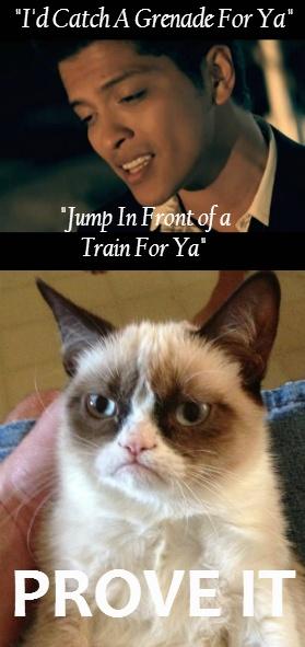 Grumpy cat listening to a Bruno Mars song.