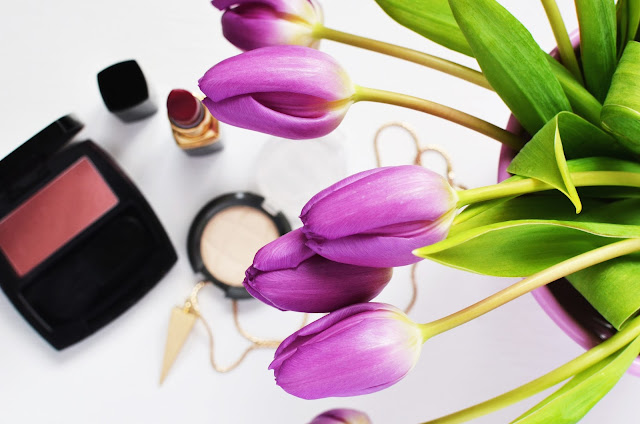 Beauty products and tulips